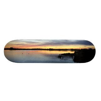 Sun putting in the lagoon of the Dew, Doñana Skate Board Decks