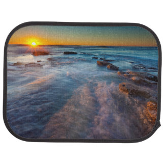 Sun rays illuminate the Pacific Ocean Car Mat