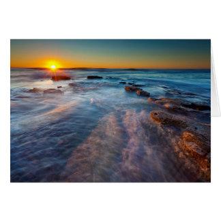 Sun rays illuminate the Pacific Ocean Card
