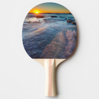 Sun rays illuminate the Pacific Ocean Ping Pong Paddle