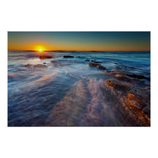 Sun rays illuminate the Pacific Ocean Poster