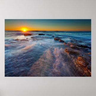 Sun rays illuminate the Pacific Ocean Poster