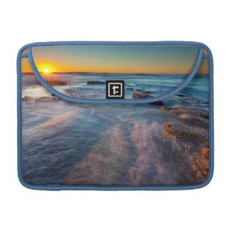 Sun rays illuminate the Pacific Ocean Sleeve For MacBook Pro