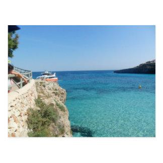 Sun, Sea and a little orange boat Postcard