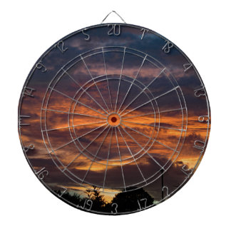 Sun set over Yorkshire Dartboard With Darts