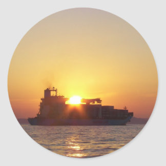 Sun Setting Behind A Container Ship Classic Round Sticker