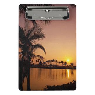 Sun setting on Anaeho'omalu Bay, Big Island Mini Clipboard