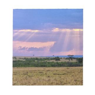 Sun setting on the Masai Mara. Notepad
