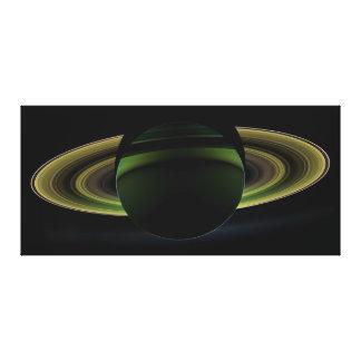 Sun Shining Behind Planet Saturn Casting a Shadow Canvas Print