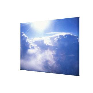 Sun shinning through clouds canvas print