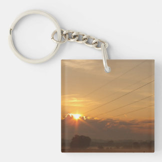 Sun surfaces above the clouds over foggy Pasture Double-Sided Square Acrylic Key Ring