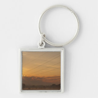 Sun surfaces above the clouds over foggy Pasture Silver-Colored Square Key Ring