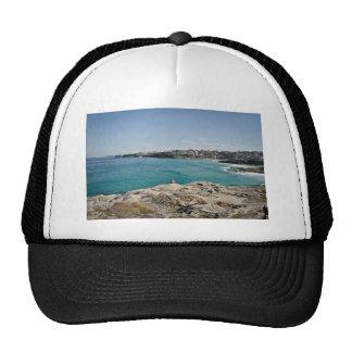 Sunbathing man in a beautiful scenery cap