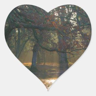 Sunbeams on misty river heart sticker