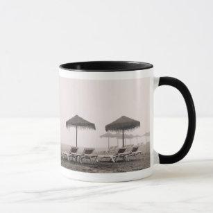 Sunbeds And Umbrella On Playamar Beach Mug