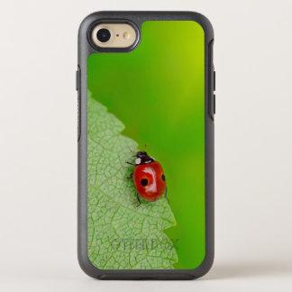 Sunburst above tiny ladybird climbing up a fresh OtterBox symmetry iPhone 8/7 case