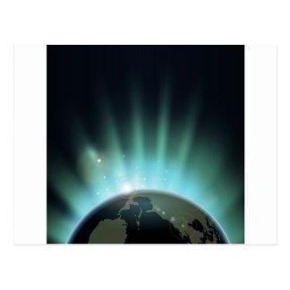 Sunburst over the world globe post cards