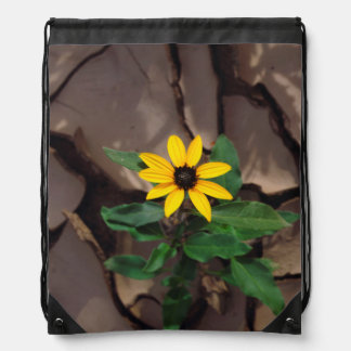 Sunflower growing from Cracked Mud Drawstring Bag