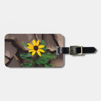 Sunflower growing from Cracked Mud Luggage Tag