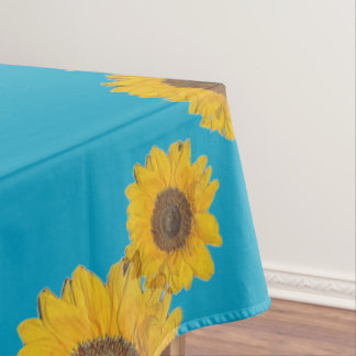 Sunflower trio in strong blue tablecloth