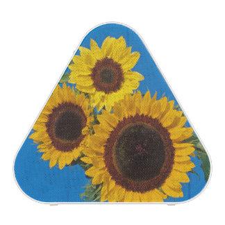 Sunflowers against blue fence