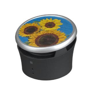 Sunflowers against blue fence bluetooth speaker
