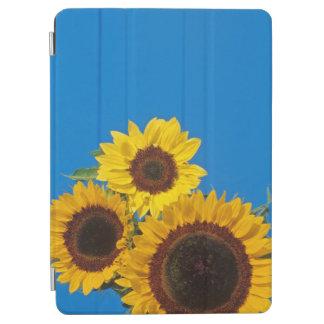 Sunflowers against blue fence iPad air cover
