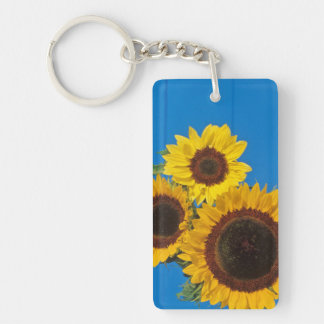 Sunflowers against blue fence key ring
