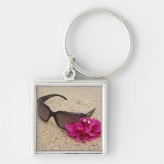 Sunglasses and bougainvillia flowers on coral key chains