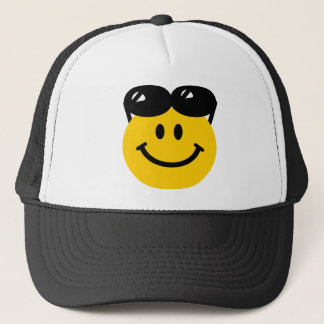 Sunglasses perched on top of head smiley face trucker hat