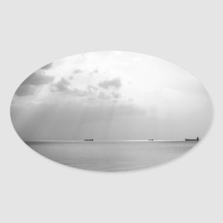 Sunrays scattered by clouds over Trieste Bay Oval Sticker