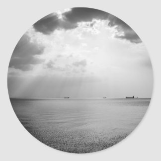 Sunrays scattered by clouds over Trieste Bay Round Sticker