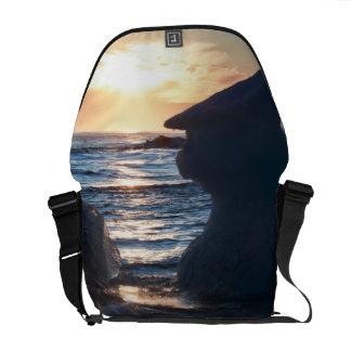 Sunrise and iceberg formation on the beach messenger bag