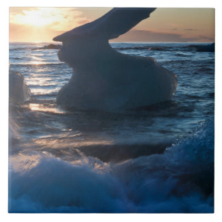 Sunrise and iceberg formation on the beach tile