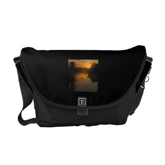 Sunrise by a lake courier bags