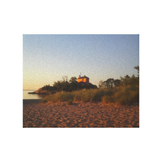 Sunrise lit beach and lighthouse in Marquette Stretched Canvas Prints