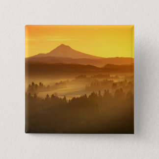 Sunrise orange colors the fog in the valley in 15 cm square badge
