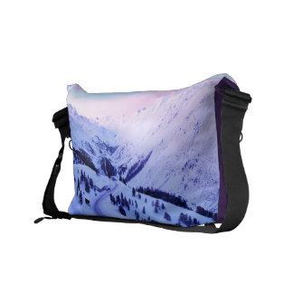 Sunrise over Snowy Mountains Courier Bags