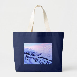Sunrise over Snowy Mountains Tote Bags
