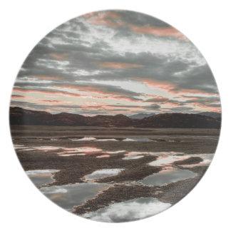 Sunrise reflections at Lago Grey Plate
