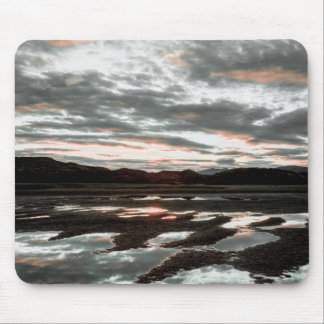Sunrise reflections at Lago Grey. Torres del Mouse Mat
