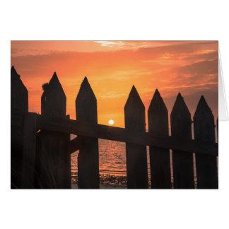 Sunrise through A fence Card
