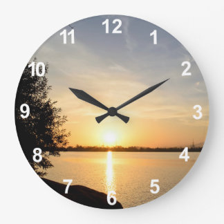 Sunset at lake wall clock