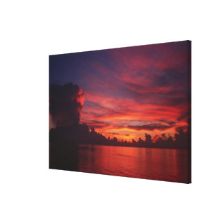Sunset at sea with dark clouds canvas print