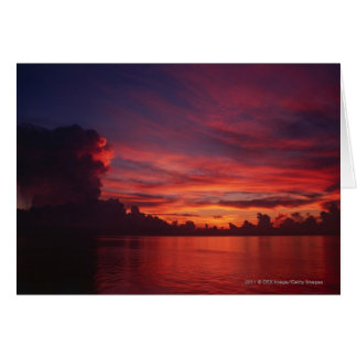 Sunset at sea with dark clouds card