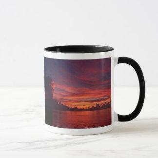 Sunset at sea with dark clouds mug