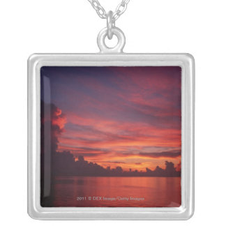 Sunset at sea with dark clouds silver plated necklace
