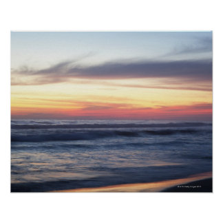 Sunset at the beach posters
