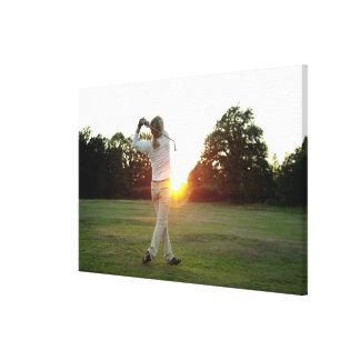Sunset golf swing canvas print