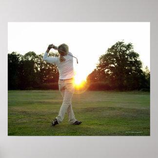Sunset golf swing poster